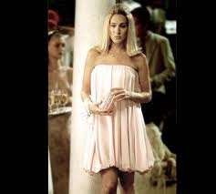Carrie, without a date at a wedding in Sex and The City
