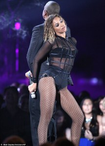 Beyonce and Jay Z at the Grammys.  Seems like Beyonce wants everyone to know she's still sexy after becoming a mother.  She's a sexy mother . . . (shut your mouth)