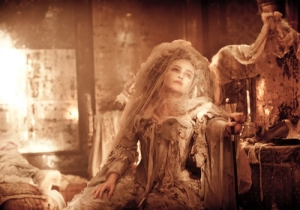 Helena Bonham Carter as Miss Havisham, wearing her tattered wedding dress. (Source: blogs.indiewire.com)